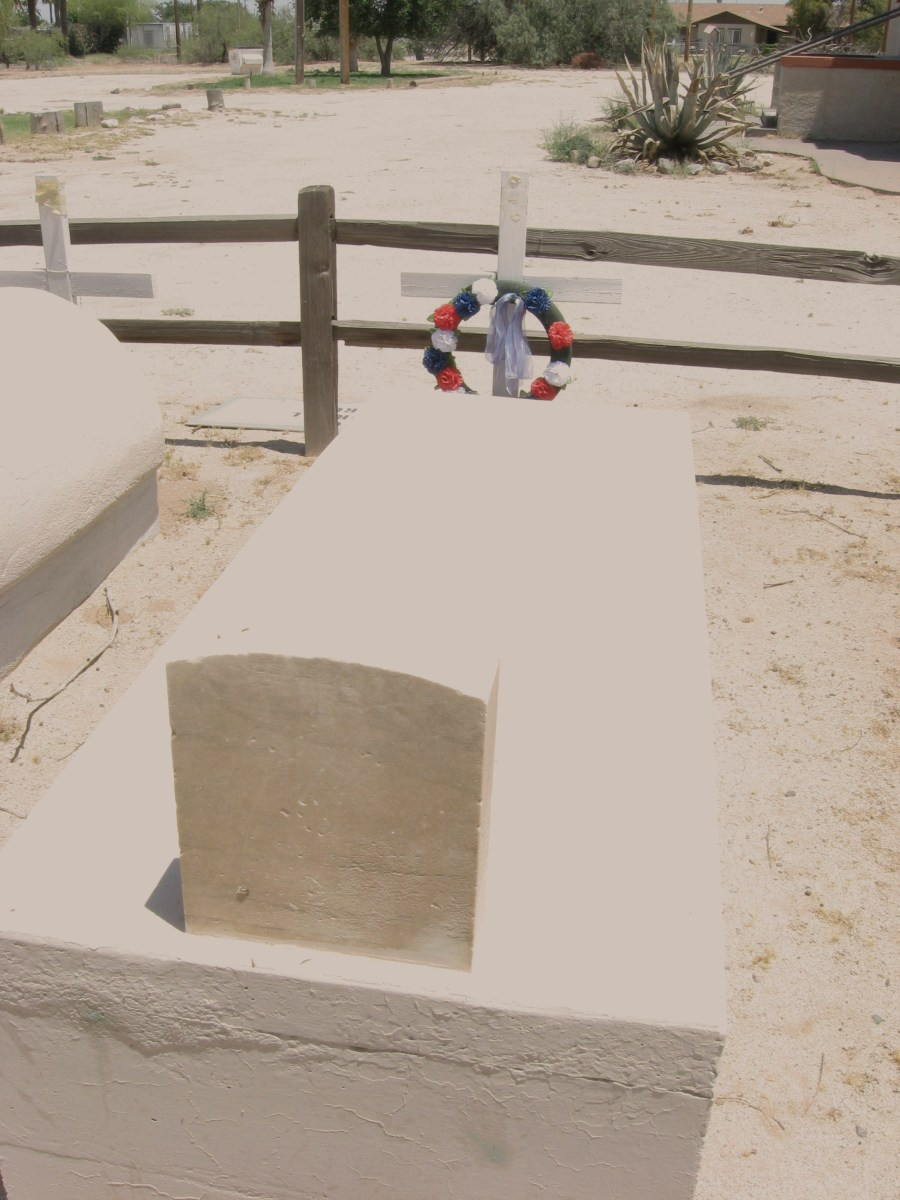 Tomb of WW I Hero, Mathew Juan is decorated with new wreath  on grounds of abandoned  Cook Memorial Presbyterian Church in Sacaton, AZ