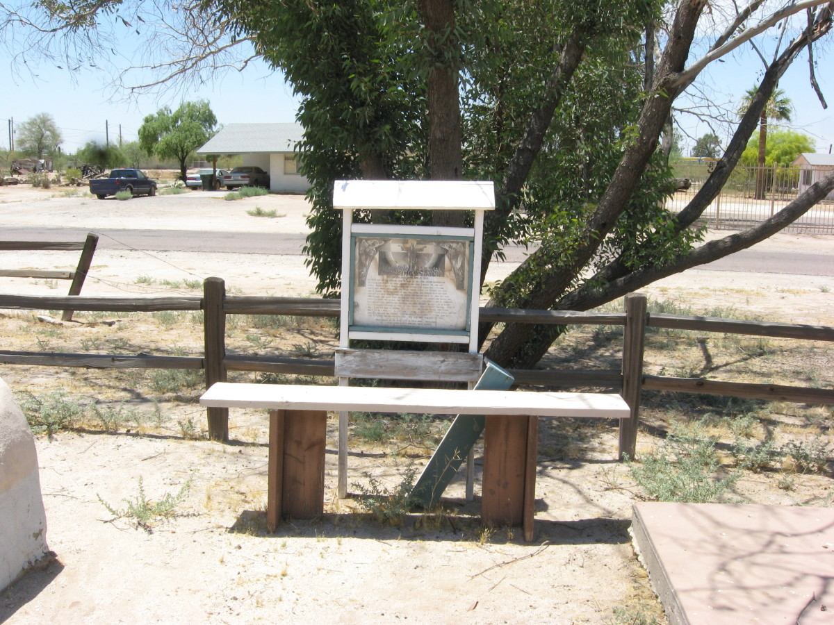 Meditation bench and crumbling information marker in cemetery of the historic Cook Church in Sacaton, Arizona