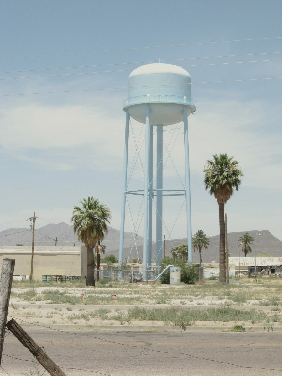 Large water tower across the street from the historic Cook Church in Sacaton, AZ