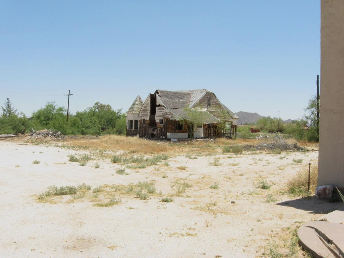 Remains of half-burned original parsonage next to Cook Church in Sacaton, AZ