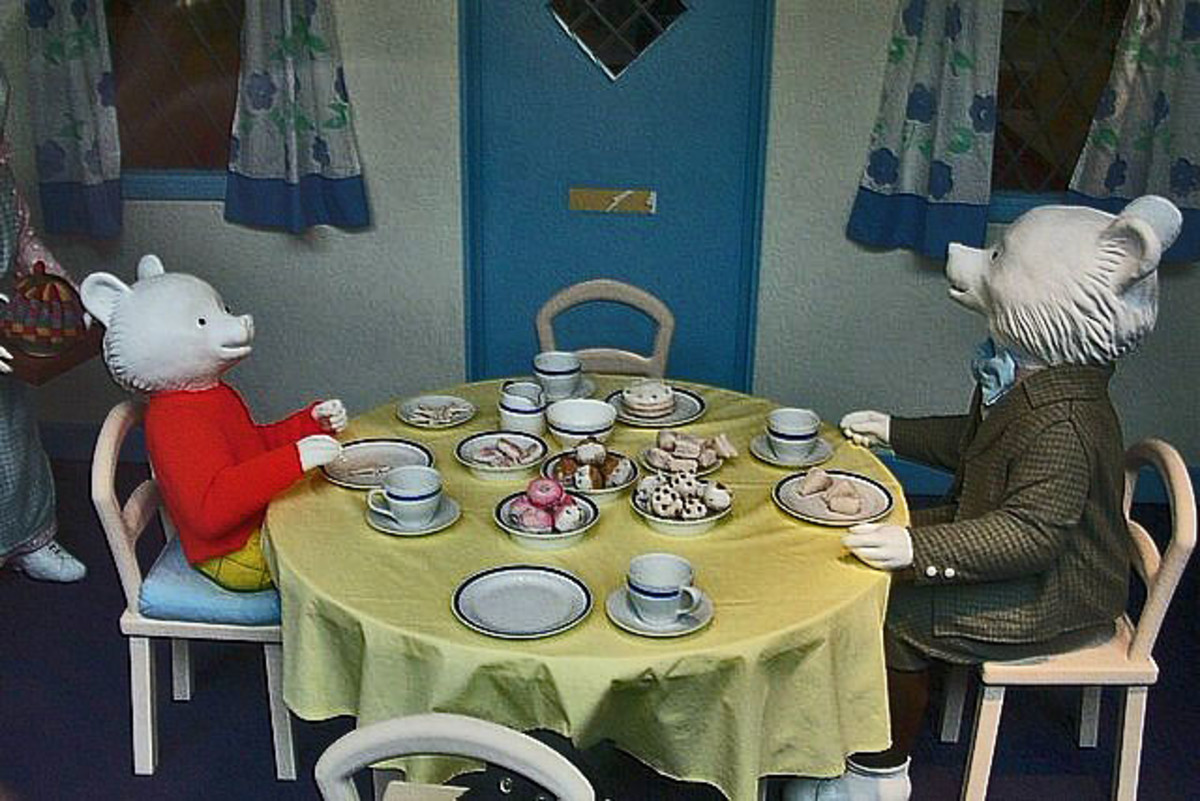 English: Museum of Canterbury with Rupert Bear Museum. The scene in the front window of the museum shows Rupert and his father having tea
