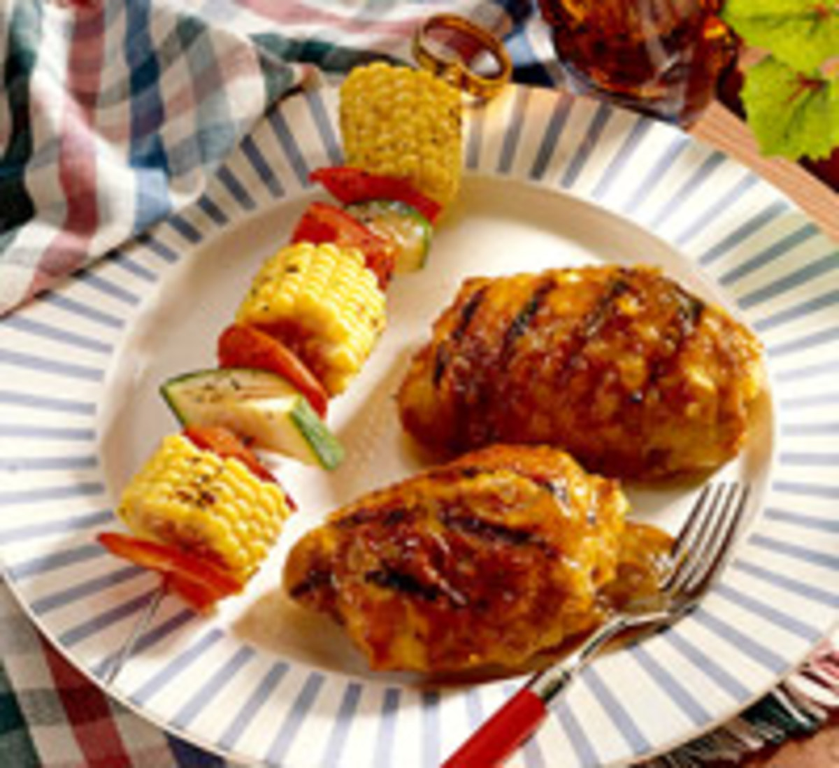 I fix skewers of baby corn on the cob , red bell pepper and zucchini and serve the skewers of the vegetables along with my skewers of barbecue chicken.