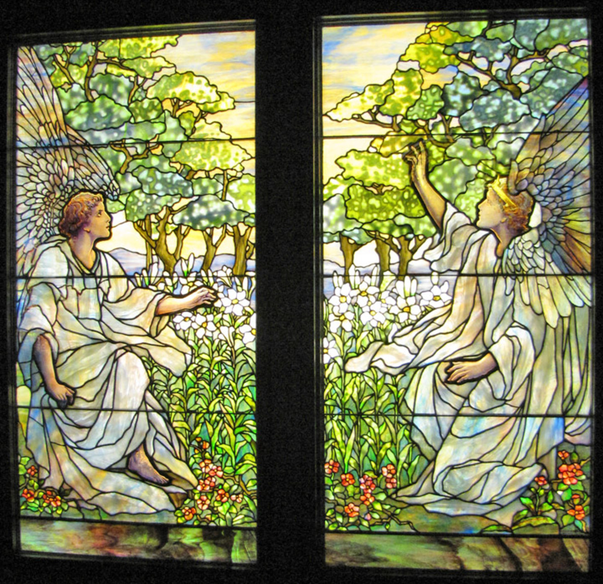 Two Stained Glass Windows with Angels in a green forest and pink flowers