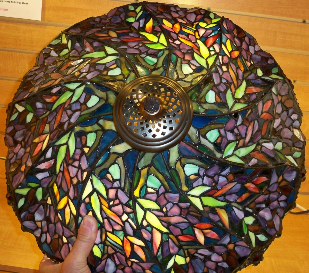 Tiffany style lamp with green blue and a mosaic of colors