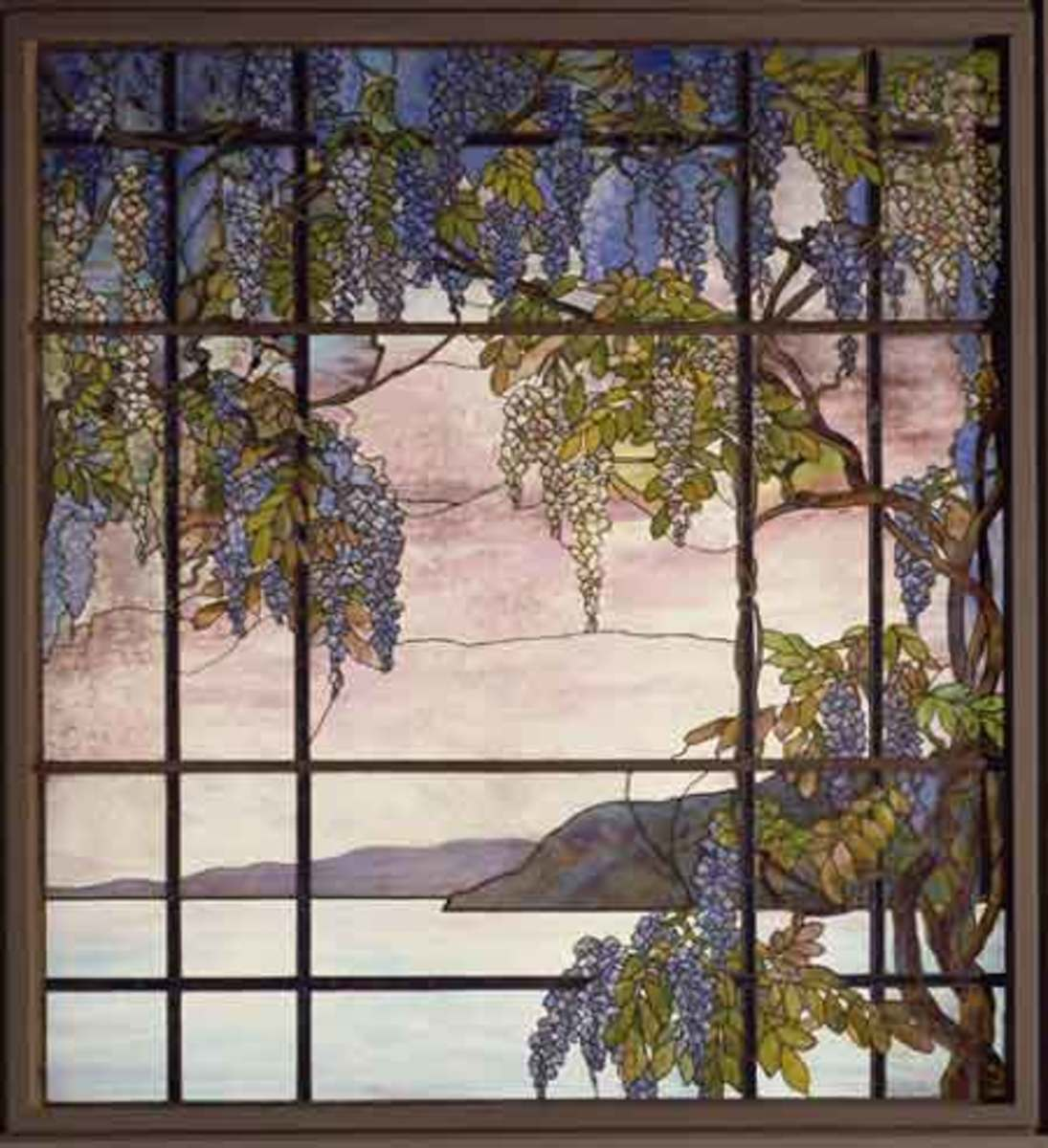 Louis Comfort Tiffany (18481933) Tiffany Studios (19021938) View of Oyser Bay , ca. 1908  Leaded Favrile-glass from the William C. Skinner House, New York City 72 3/4 x 66 1/2 in (184.8 x 168.9 cm )  Lent to The Metropolitan Museum of Art by The Char