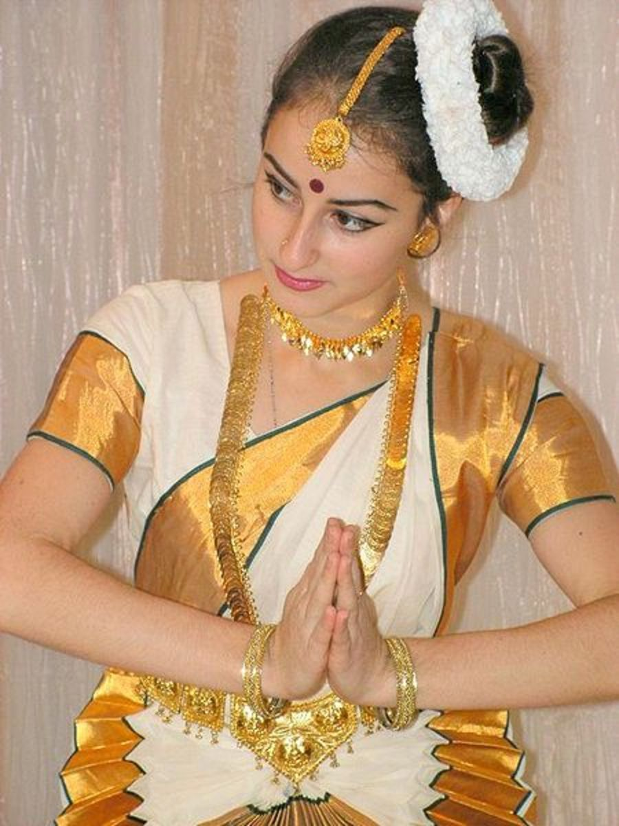 A traditional dancer making a Namaste gesture.