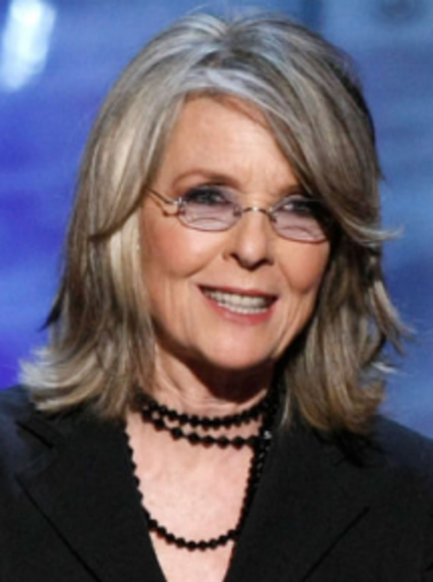 Diane Keaton sports a shoulder length layered cut.