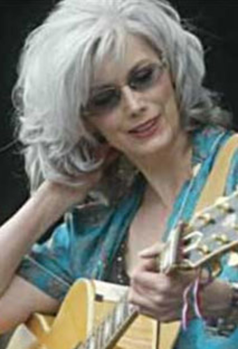 Emmylou Harris still looking beautiful with her abundan shoulder length hair.