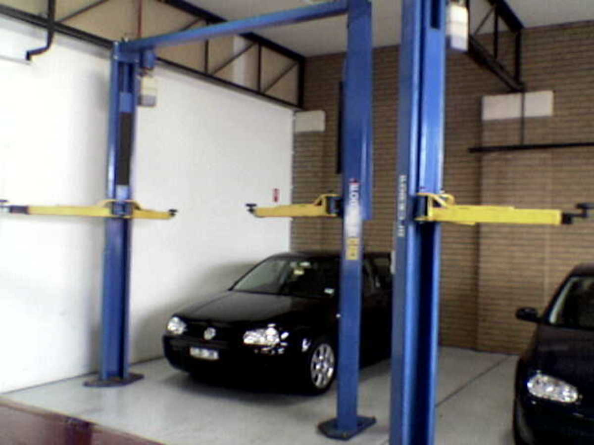 2 post clear span auto lifts or hoists, shown here in a nice high roof auto shop