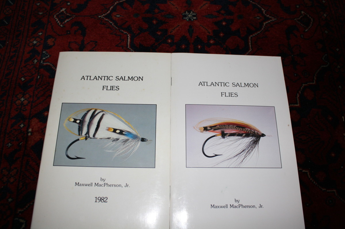 """Front covers of my second (on left) and third """"Atlantic Salmon Flies"""" catalogs. 10/0 """"Lady Amherst"""" (left) and 8/0 """"Black Dog"""", both dressed on 120 year old tapered shank hooks with silkworm gut eyes"""