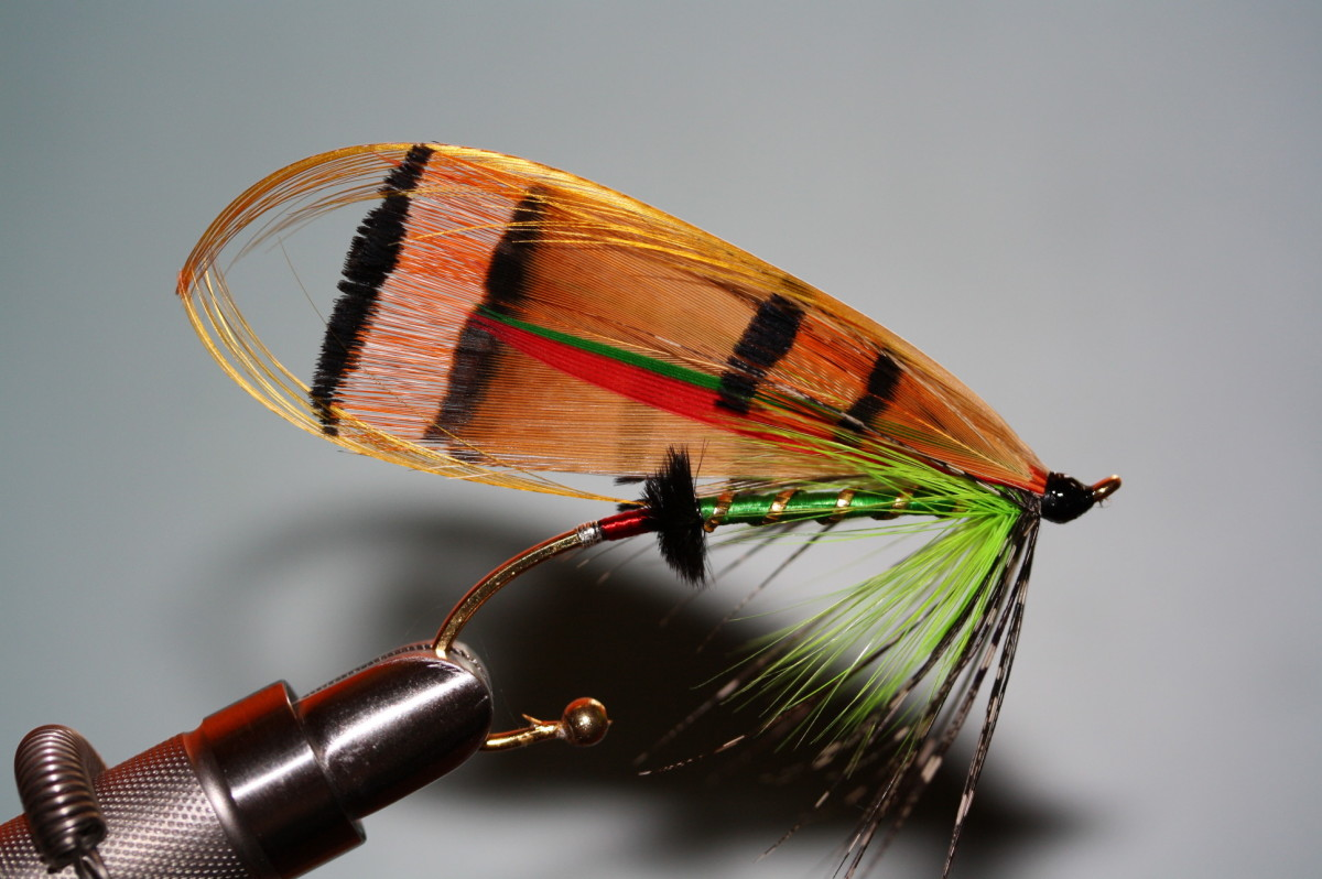 "This is a salmon fly I dressed today called ""Utah Girl"". Though we don't usually fish for Atlantic salmon at night, if we did, this one would do the trick!"