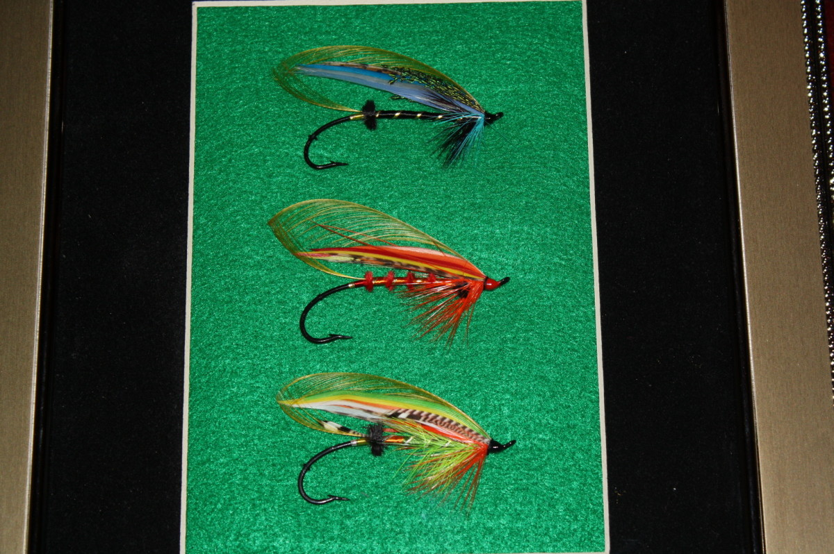 "Same three salmon flies shown above, but a closer shot. Top fly is ""Little Bo Peep""; middle fly ""Sunset"" and the bottom pattern is the ""Green Highlander Variant."