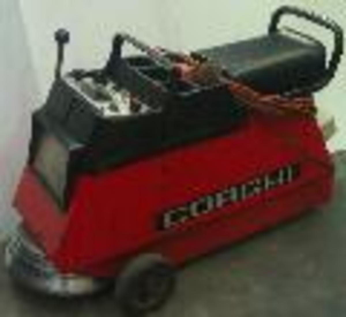 I always need one of these Corghi sit on finishing wheel balancers.