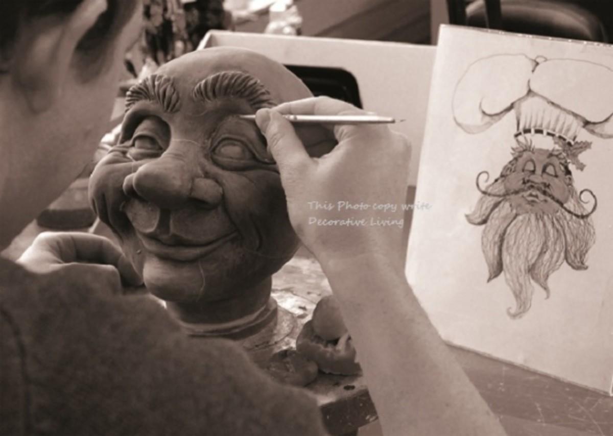 artist making head of doll