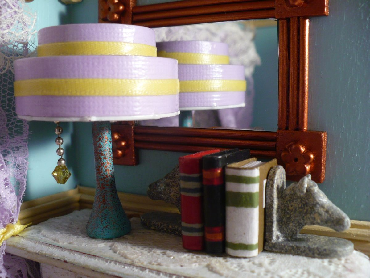 Learn how to make your own dollhouse miniatures with tutorials for a miniature art deco dollhouse lamp, miniature books, and miniature horse head bookends.