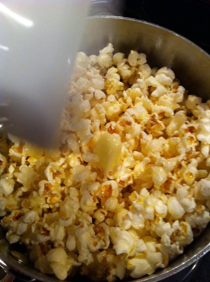 Shaking salt on popcorn