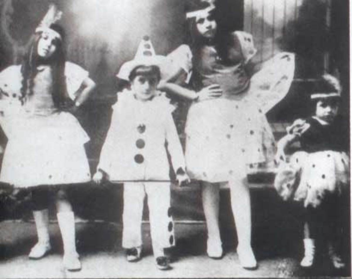 In carnival costume with siblings