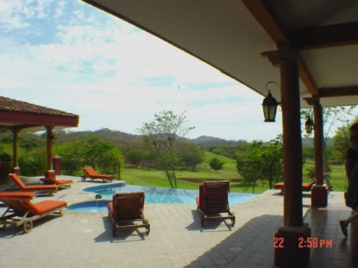 Small condo pool and BBQ area at Reserva Conchal