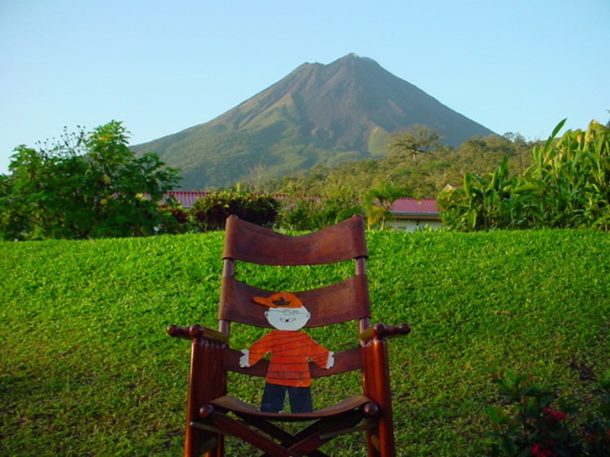 My granddaughter sent Flat Stanley on a Costa Rica adventure with me.  Here he is in the early morning hours in front of Volcan Arenal.  If you look really close you can see a puff of ash from the volcano.