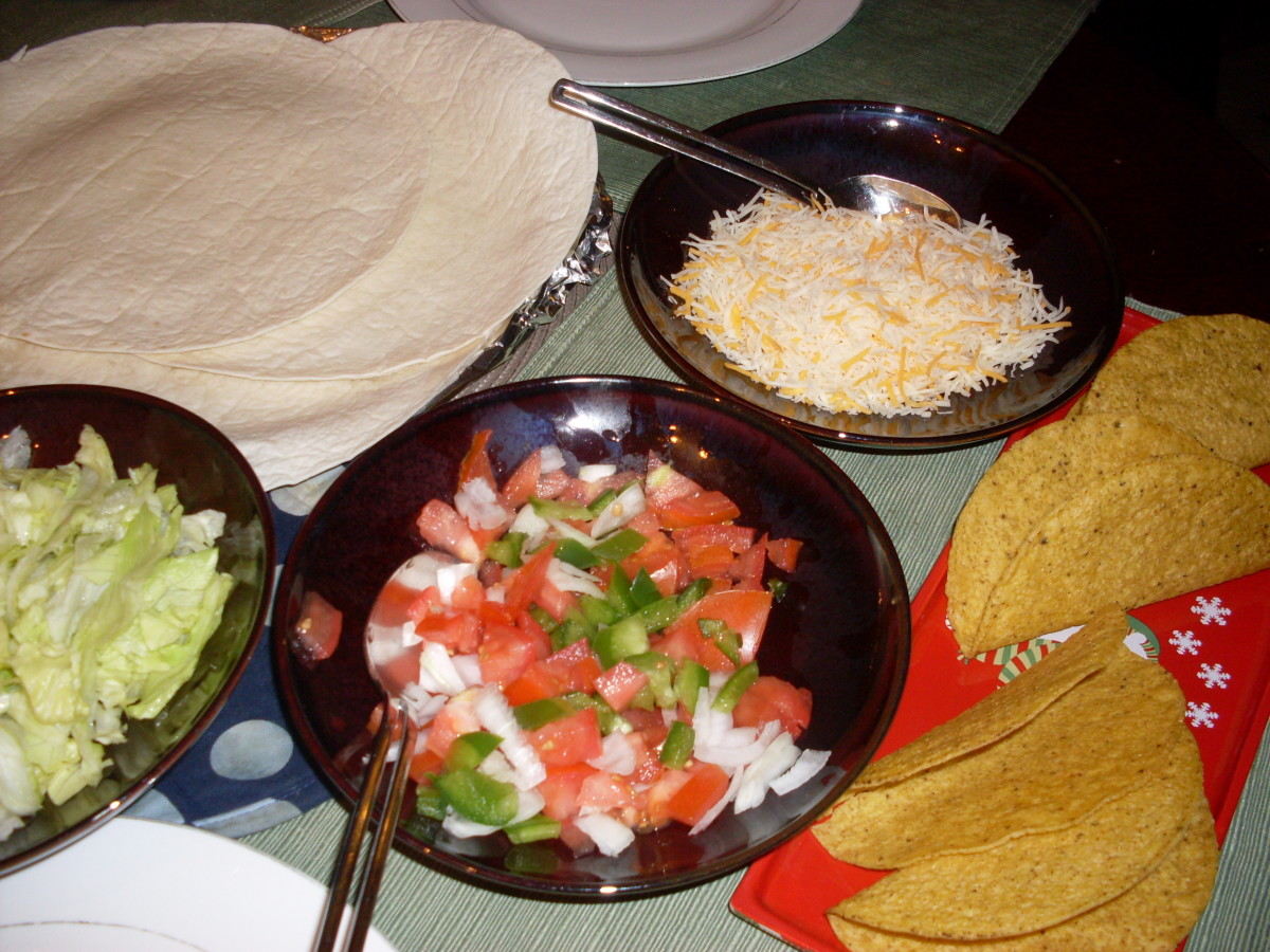 diced tomatoes, chopped green bell peppers and/or red peppers, and onions, as well as shredded cheese and lettuce are all great fixings for chicken tacos.