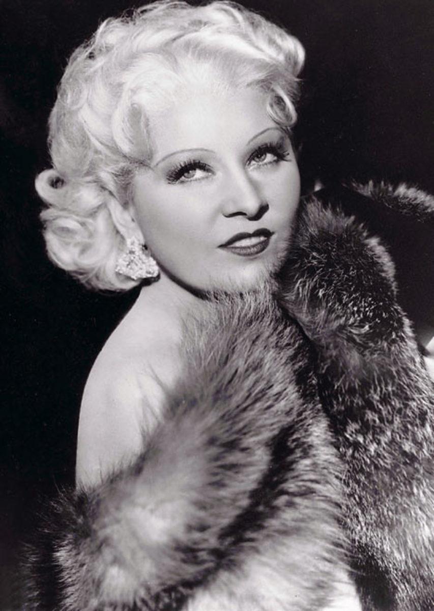 Mae West wearing curly medium length bob hair style