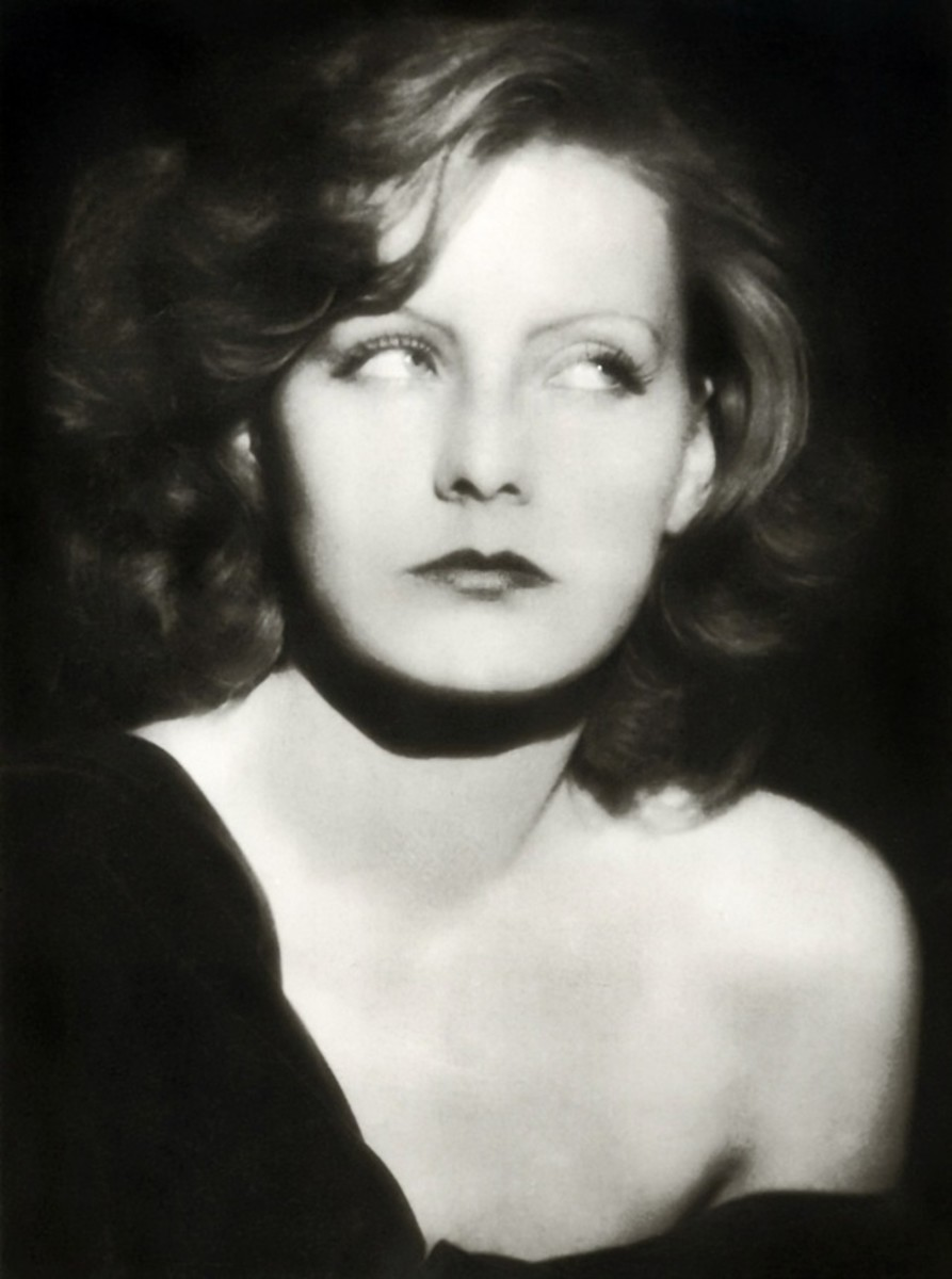 Greta Garbo, 1927, wearing curly medium length bob hair style