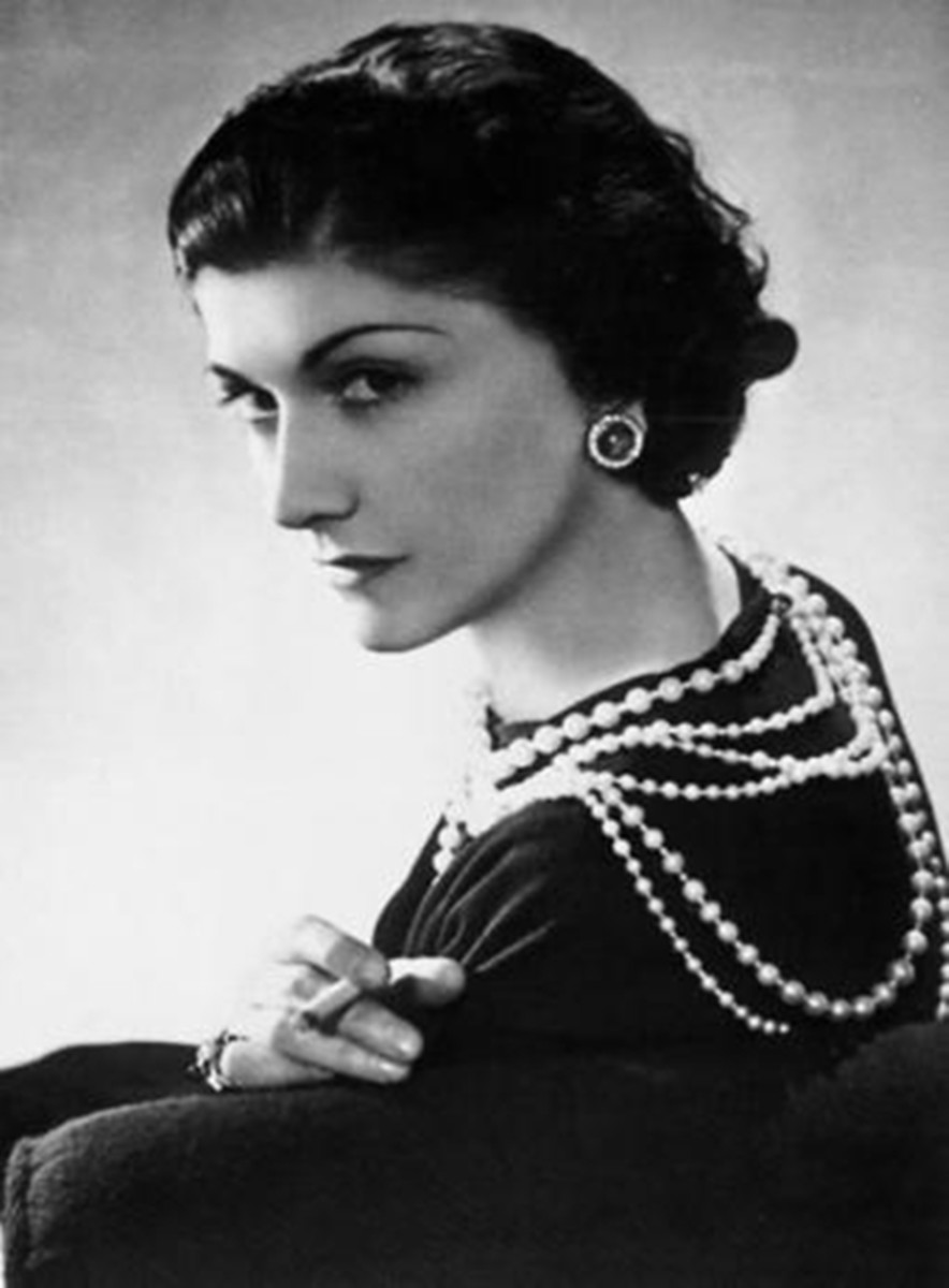 Coco Chanel wearing curly medium length bob hair style