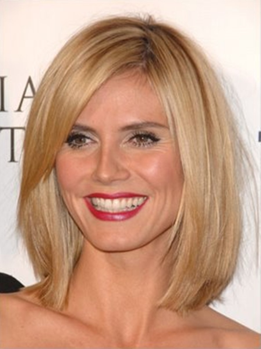 Long angled bob hair style. Straight, a little layered and jagged cut
