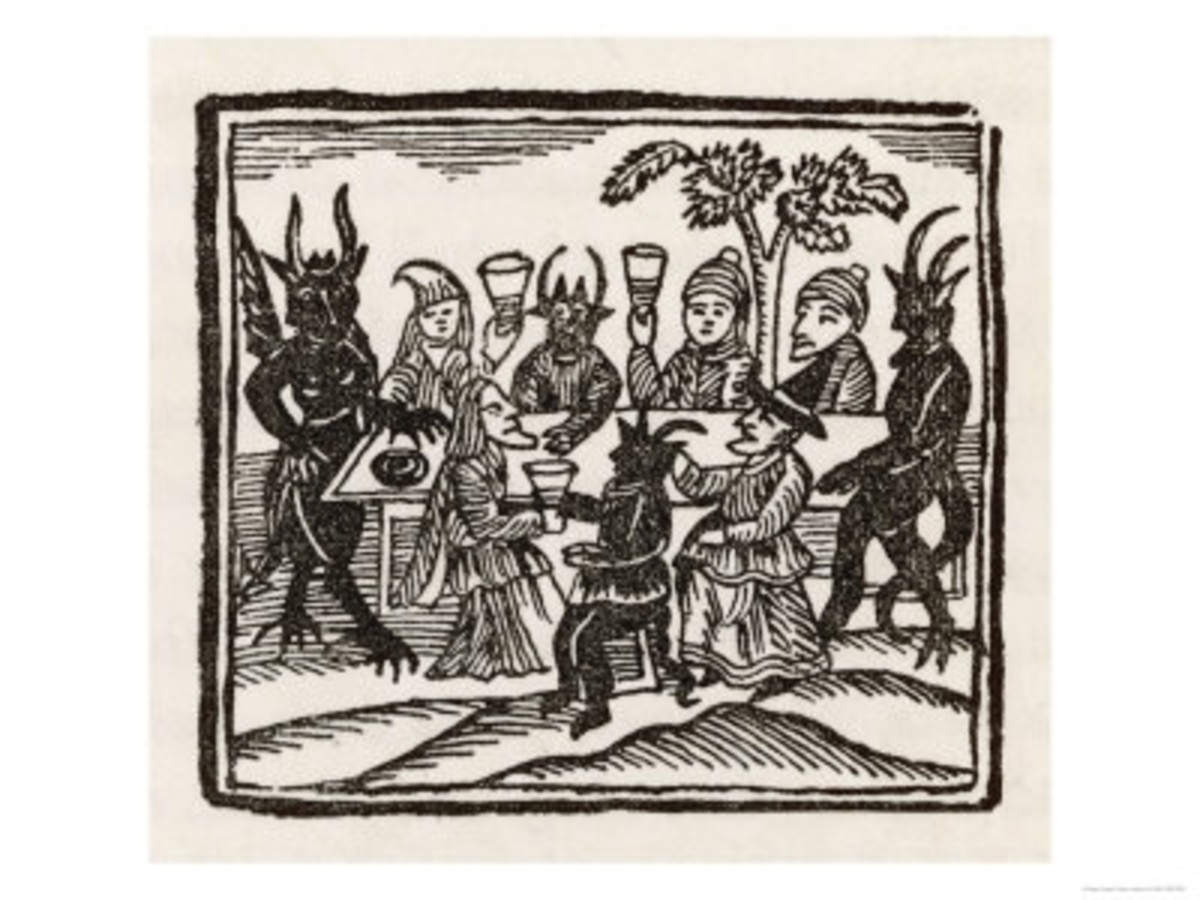 Dining with demons, witches at a Sabbat sit down to supper with the Devil and his companions.