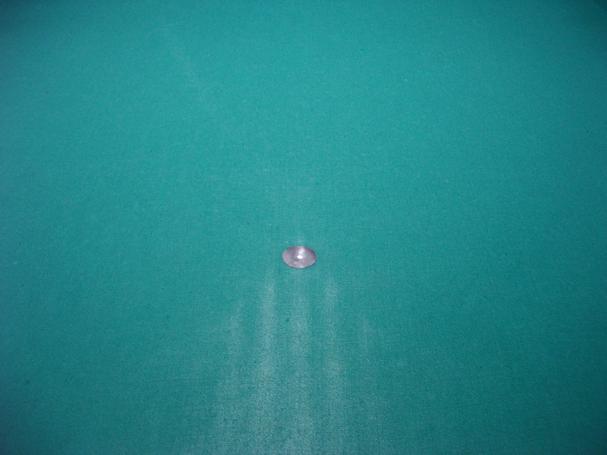 This photograph shows the marks made by pushing the tightened balls up towards the spot, instead of rolling them up.