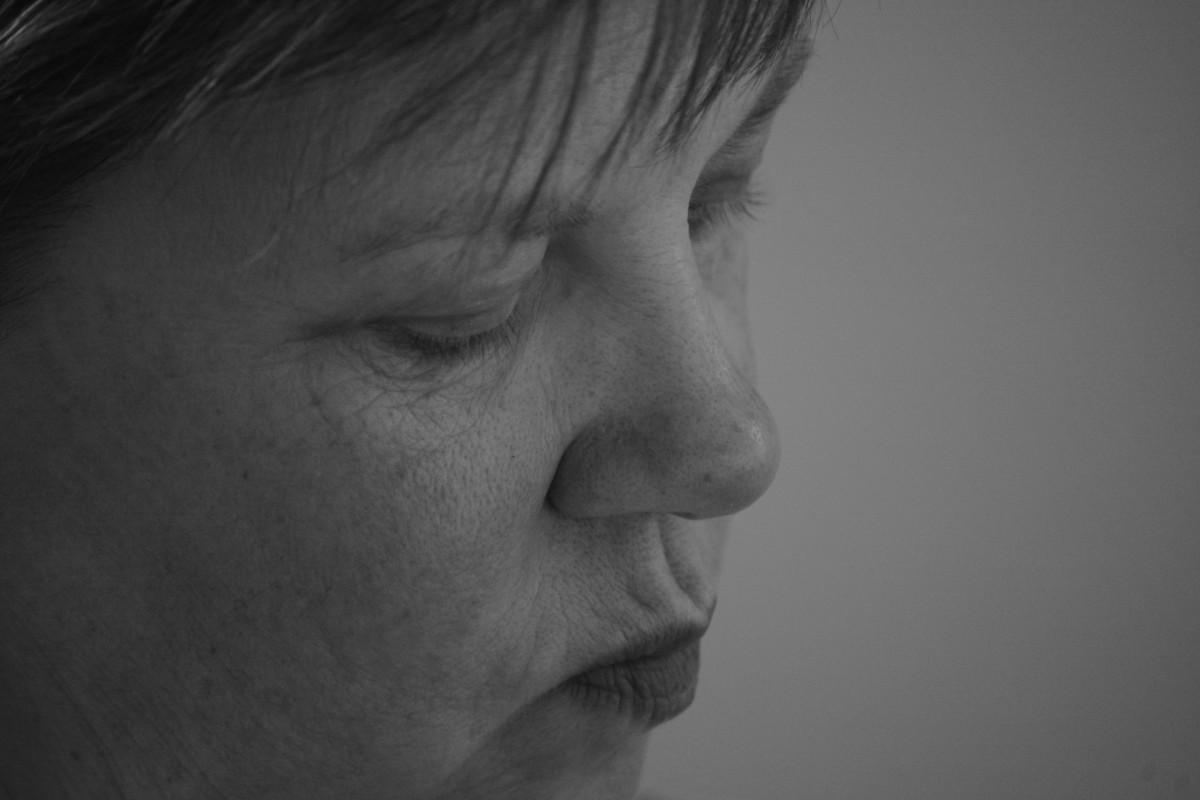 Involuntary mouth movements are a symptom of Tardive Dyskenisia.