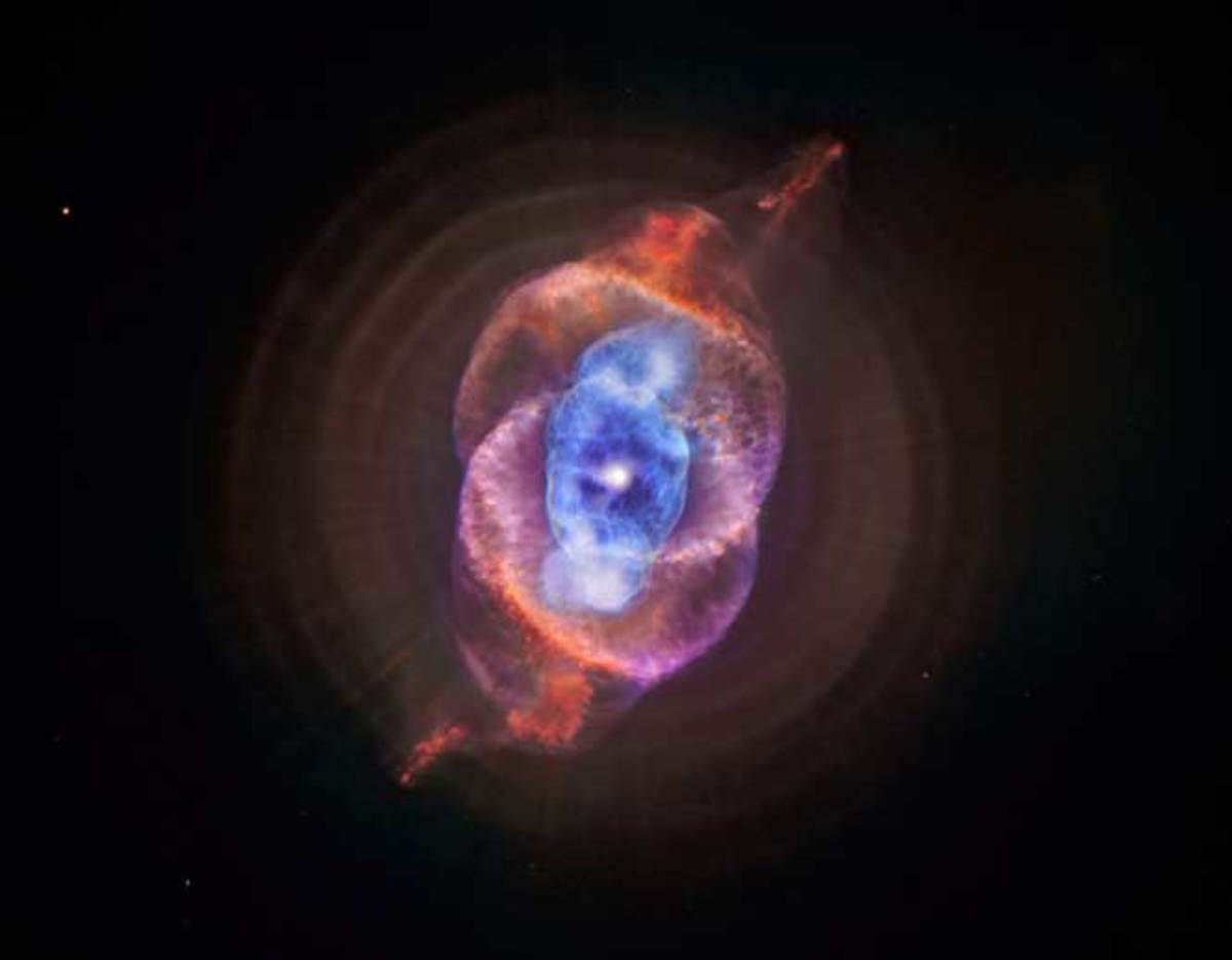 "The Cat's Eye Nebula is a beautiful example of a so-called ""planetary nebula,"" thought by early astronomers to resemble a planet, but now known to be the death throes of a Sun-sized star."