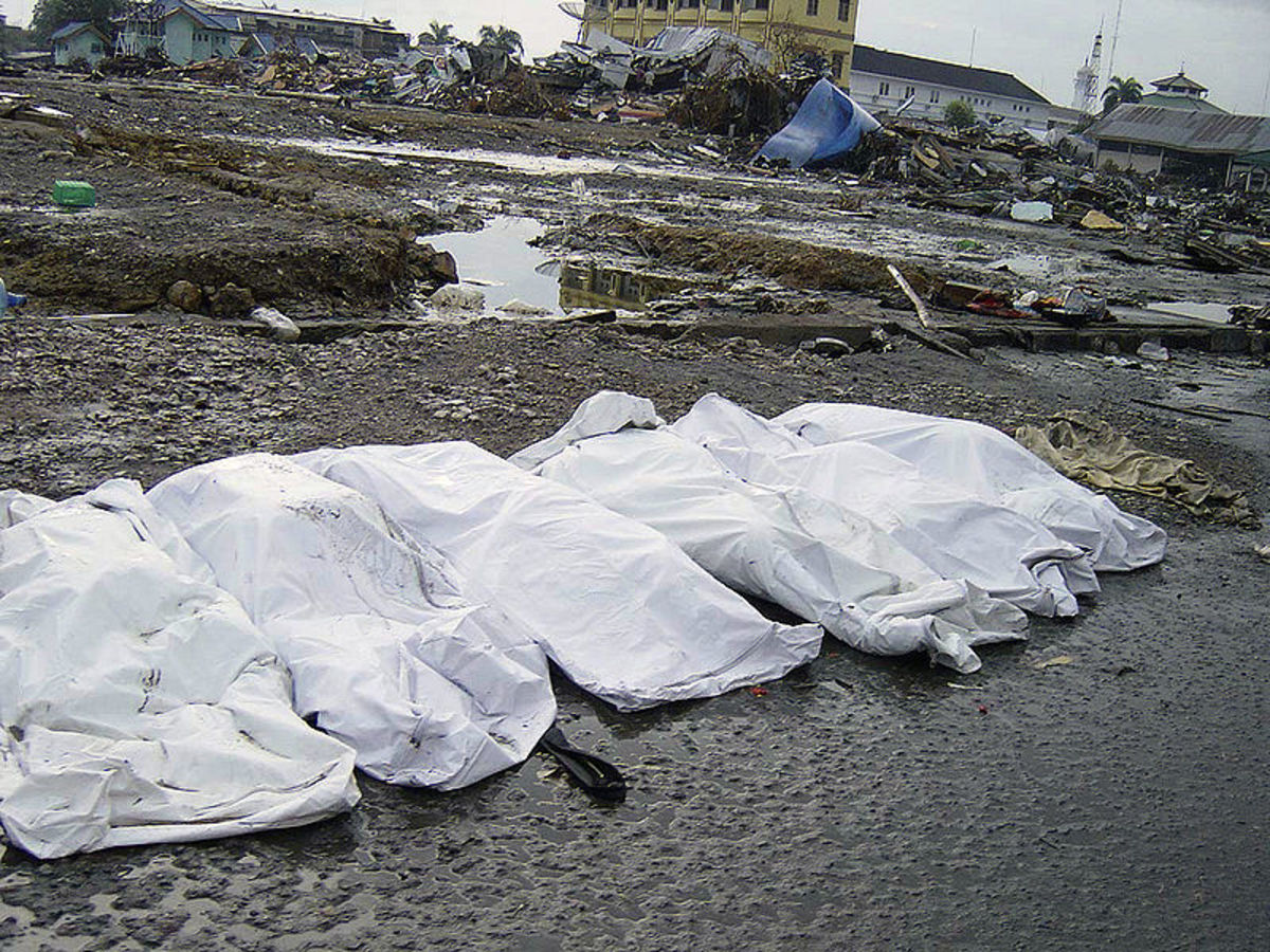 Amid trash and debris, the shrouded bodies of the deceased lay on a street in downtown Banda Aceh, Sumatra, Indonesia, following the massive Tsunami that struck the area on December 26, 2004.