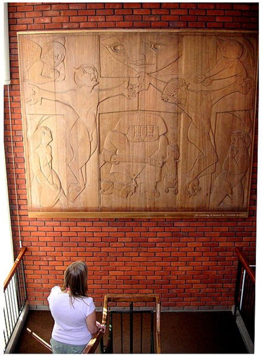 Photo of Connor Barrett's mahogany wood carving, The Crucifixion of Mankind, located in the Colchester Public Library, England . The picture was taken by Sandie Keeble of the Colchester library staff for Carptrash 14:17, 2 September 2006.