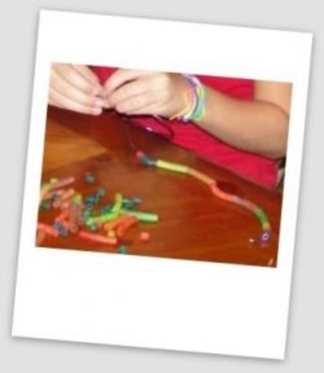 "Threading colored pasta ""beads"" to make Seminole-inspired necklaces"