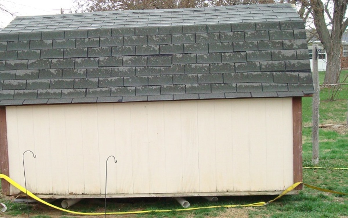 Notice the pipes under the shed, and the strapes around it.