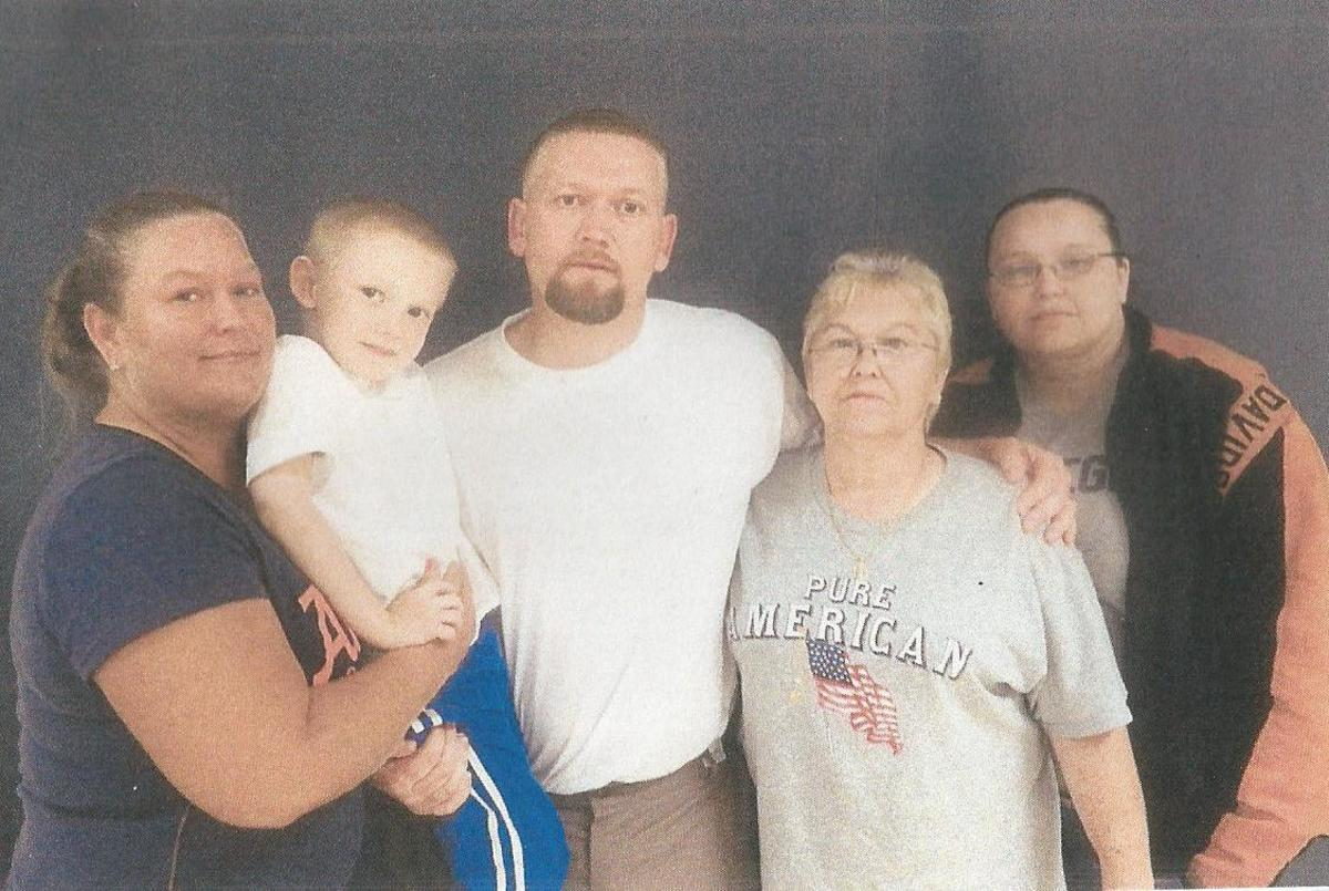 Here you have Michaels Sister Amanda on the far right. Coming left is his Mom Carolyn, then Michael, Michael's son Michael, and then his sister Dana. This photo was taken while Michael has been in prison.