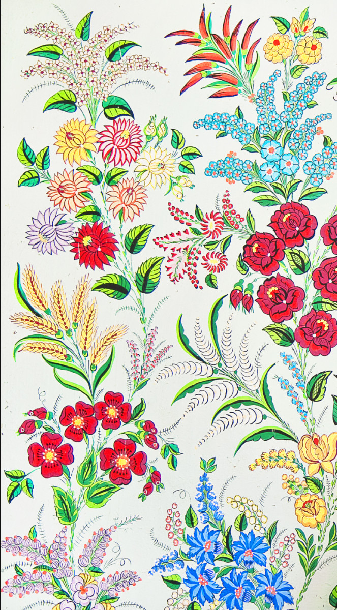 Can you name the flowers? Roses, dahlias, bellflowers are some of those included in this floral design.