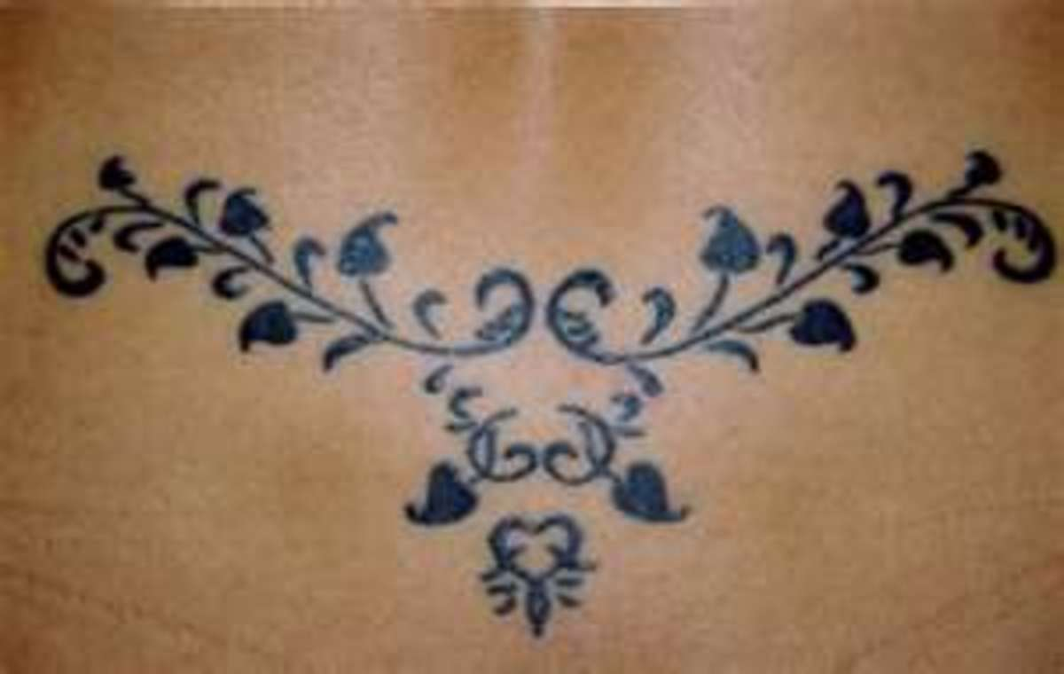 Dainty Women's Lower Back Tattoos