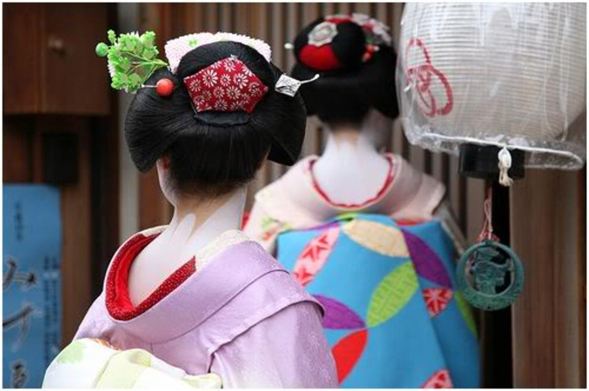 Ofuko - the famous hair-do of a geiko. The neck of a geisha is open to the view as it is considered the most seductive part of a woman.