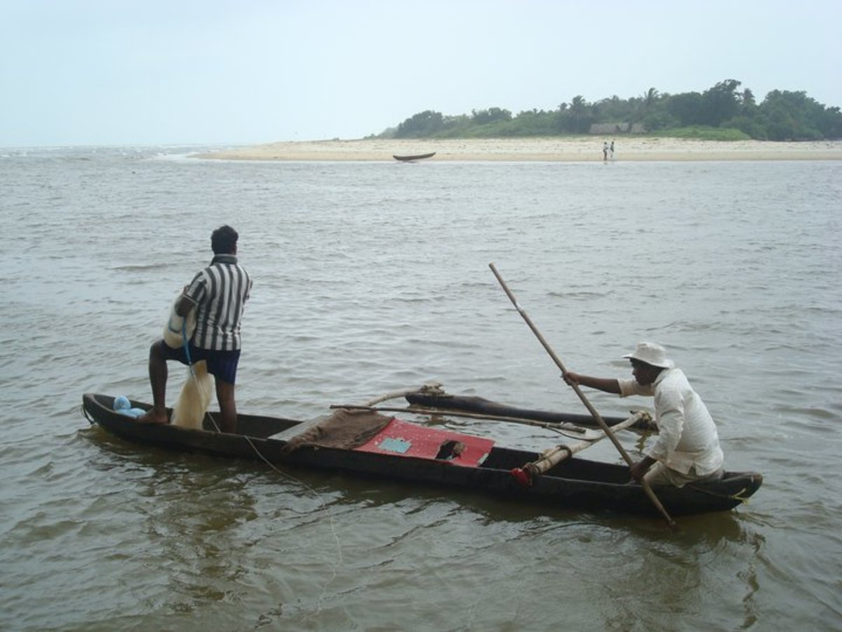 Fishing in a canoe where River Sal meets the Arabian Sea
