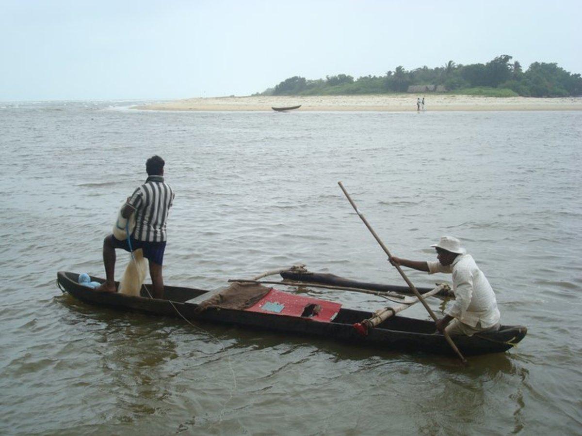 Fishing in a canoe where River Sal meets the Arabian Sea