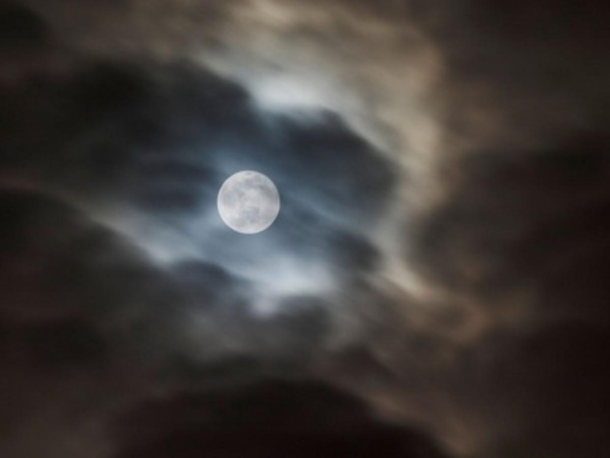 Moonrise through fall mist.