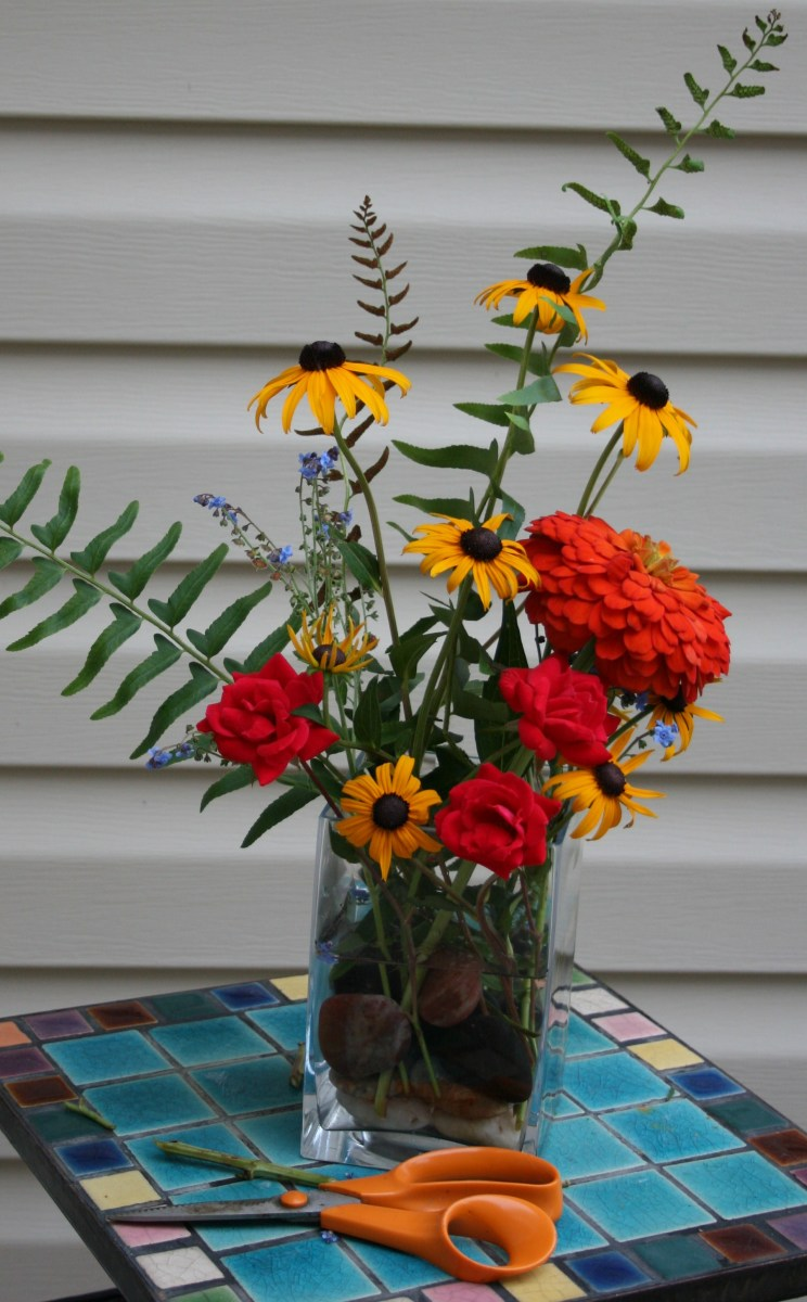 Either in an arrangement or a flower bed, Rudbeckia always provides a friendly welcome home.