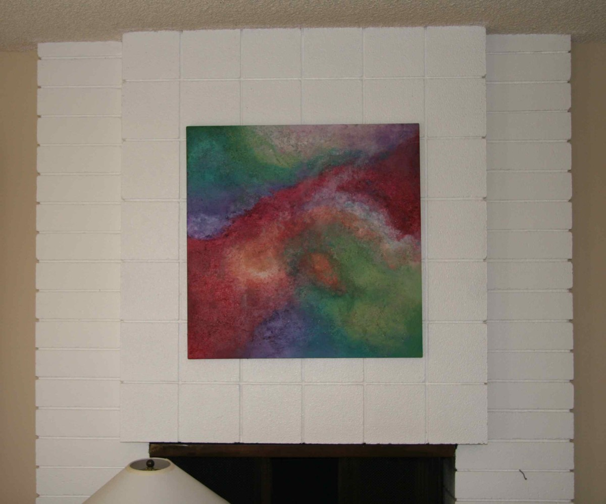 Use a highly saturated white painted fireplace to highlight artwork