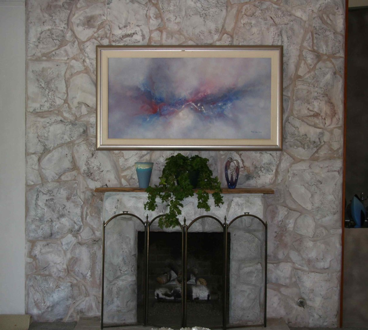 A third, random paint of architectural white paint was applied to lighten and add a stronger textural look to this fireplace