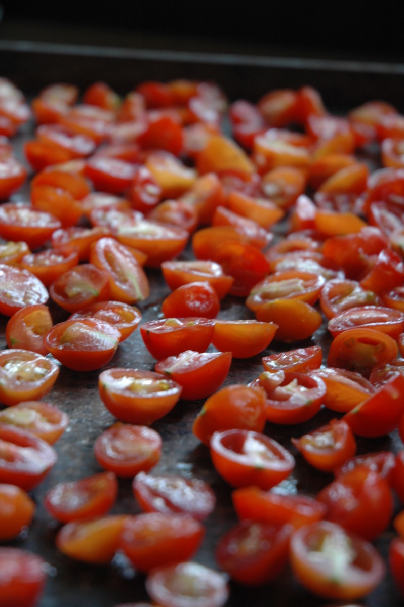 Cut the cherry tomatoes in half and remove the seeds.