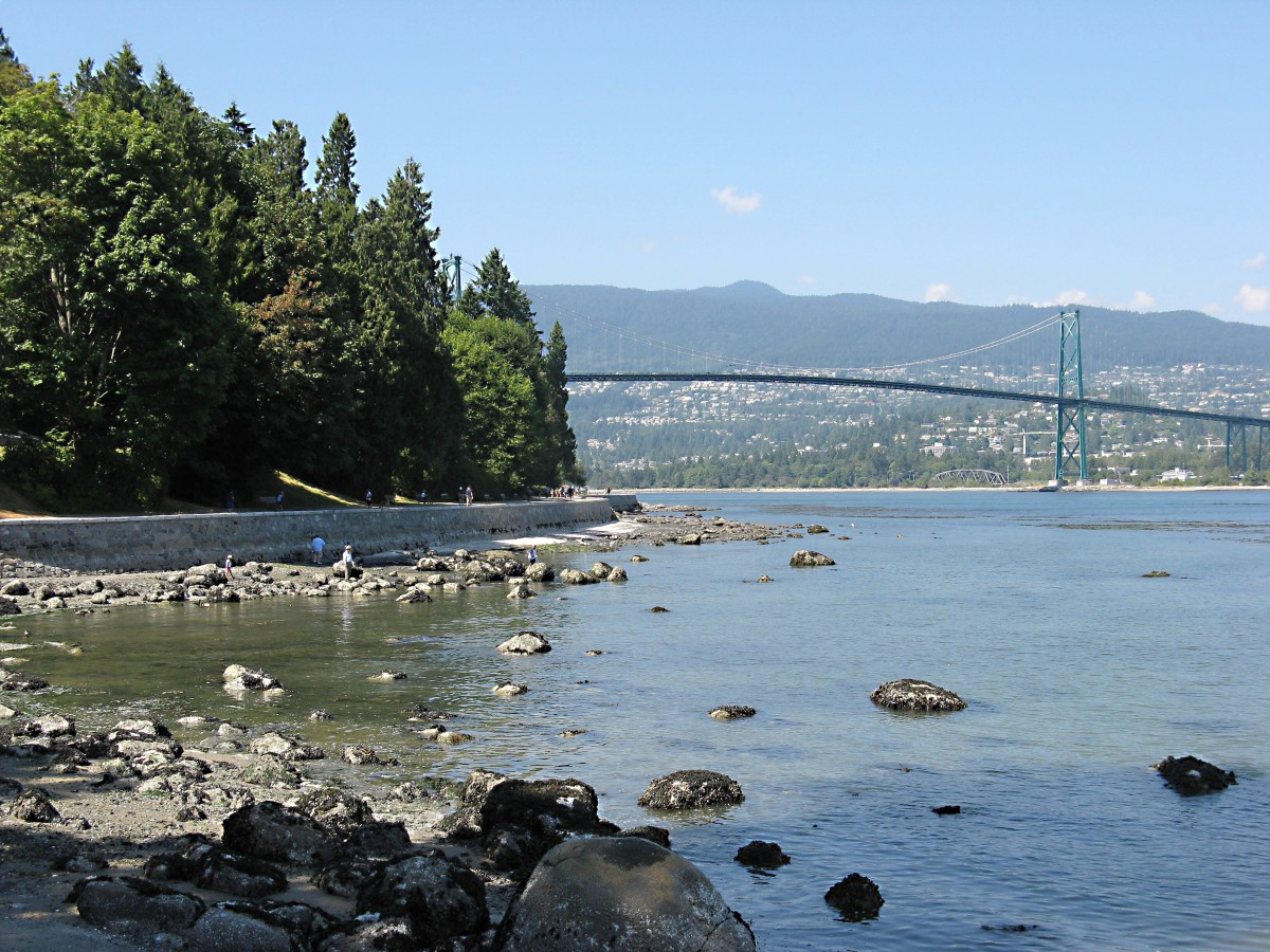 A view from a rocky beach in Stanley Park; Lion's Gate bridge is in the background