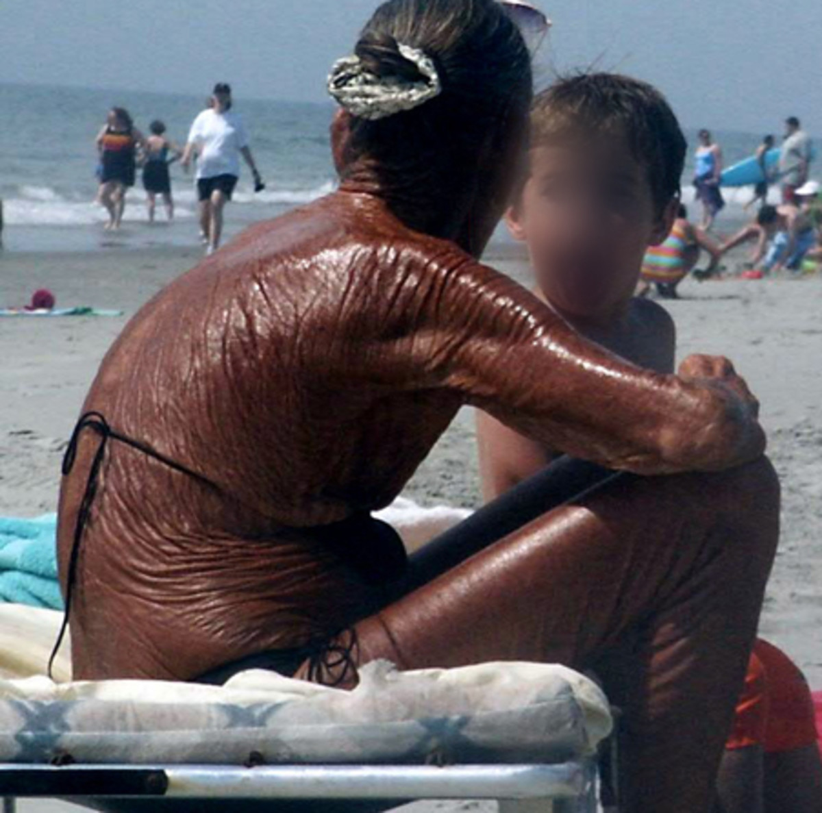 This woman's skin is like pure leather. Wrinkled and burned. It is so aged, she looks at least 80 years old.