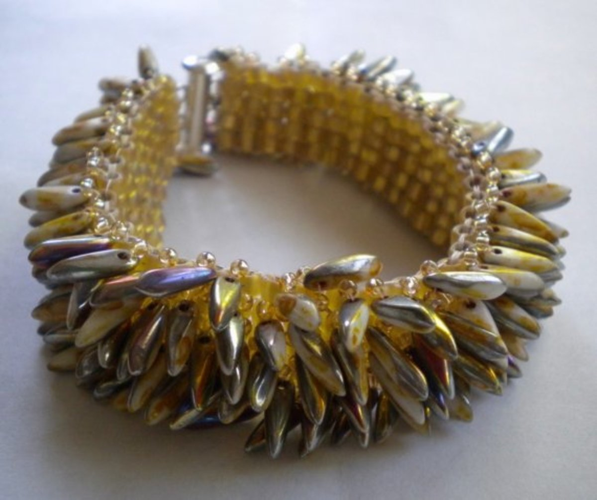 I've admired this bracelet for a long time.  This is a great option for a wider cuff, although you can adjust the width however you like.  I love the side detail.  You could easily add more.